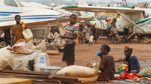 Thousands have taken refuge at a makeshift internally displaced person's camp near Bangui airport in the Central African Republic. Muslims are fleeing out of the country. by Pan-African News Wire File Photos