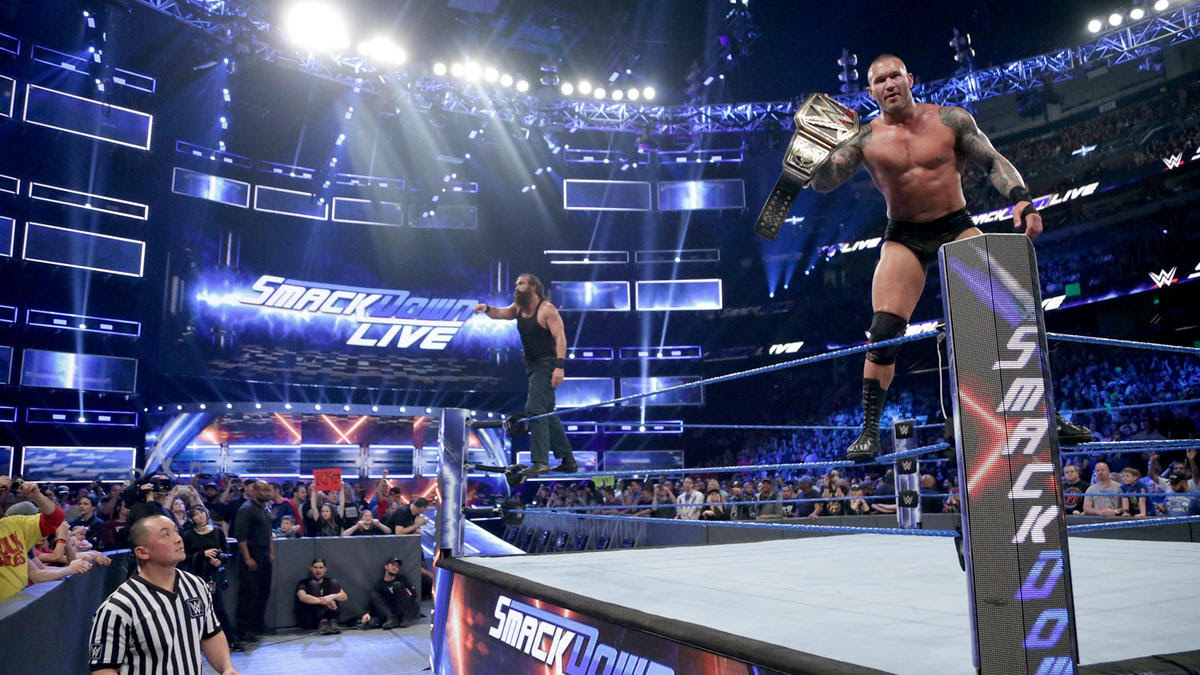 The WWE Champion & Harper stand victorious.