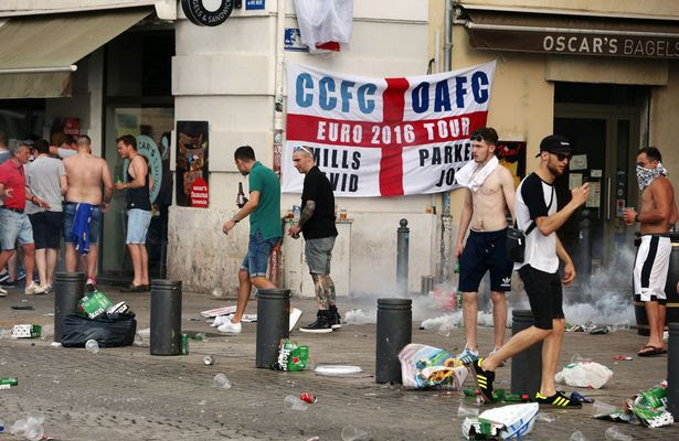 French police fire tear gas as they clash with English football fans at The Queen Victoria pub in Marseille ahead of the first game in Euro 2016