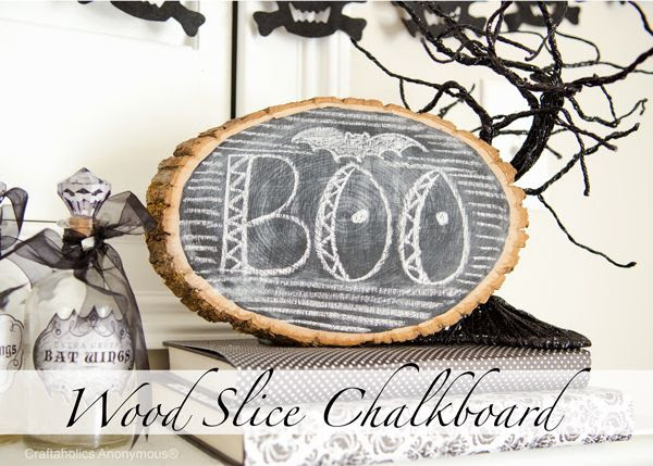 Turn a wood slice into a chalkboard. Clever! #halloween #craft