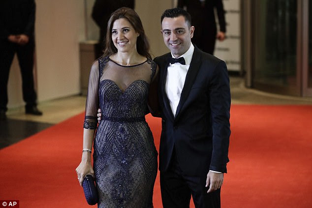 Al-Sadd midfielder Xavi poses with wife Nuria Cunillera as they arrived ahead of the wedding