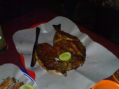 A grilled butterflied fish on Jimbaran Beach