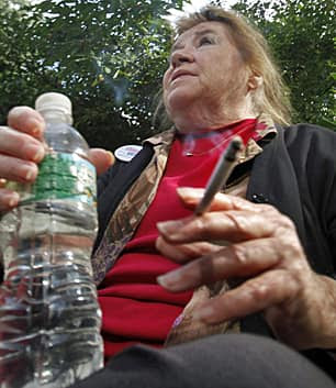 Barbara Fischer, from Staten Island, N.Y., smokes in City Hall Park on Oct. 14, 2010, in New York. The city has banned smoking in public parks, on beaches and in pedestrian plazas.