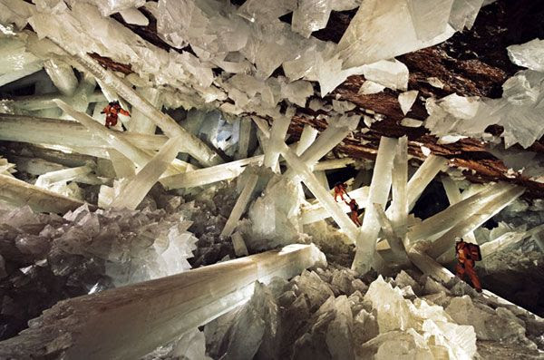 Clad in protective ice-cooled jumpsuits, explorers make their way through the Cave of Crystals in Mexico.