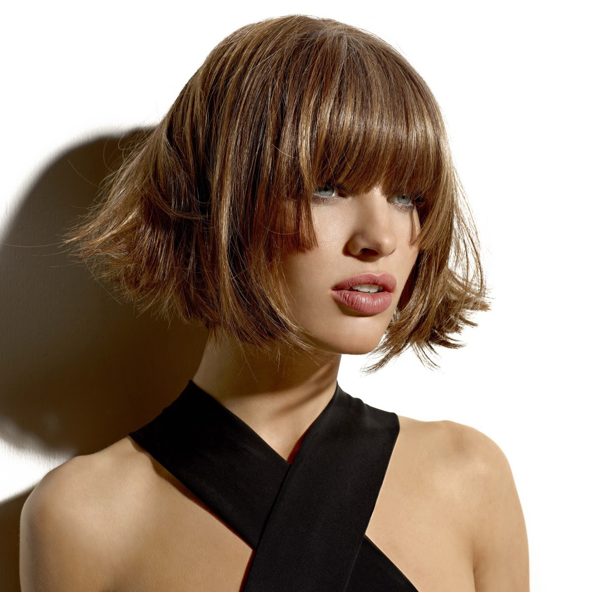 Short chin length trapeze shape bob with flipped out ends ...