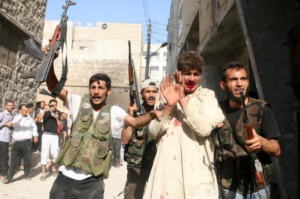 Obama autorizou apoio secreto a rebeldes sírios, diz televisão americana Emin Ozmen/AFP