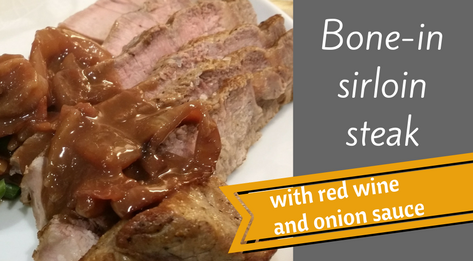 bone-in sirloin steak with red wine and onion sauce