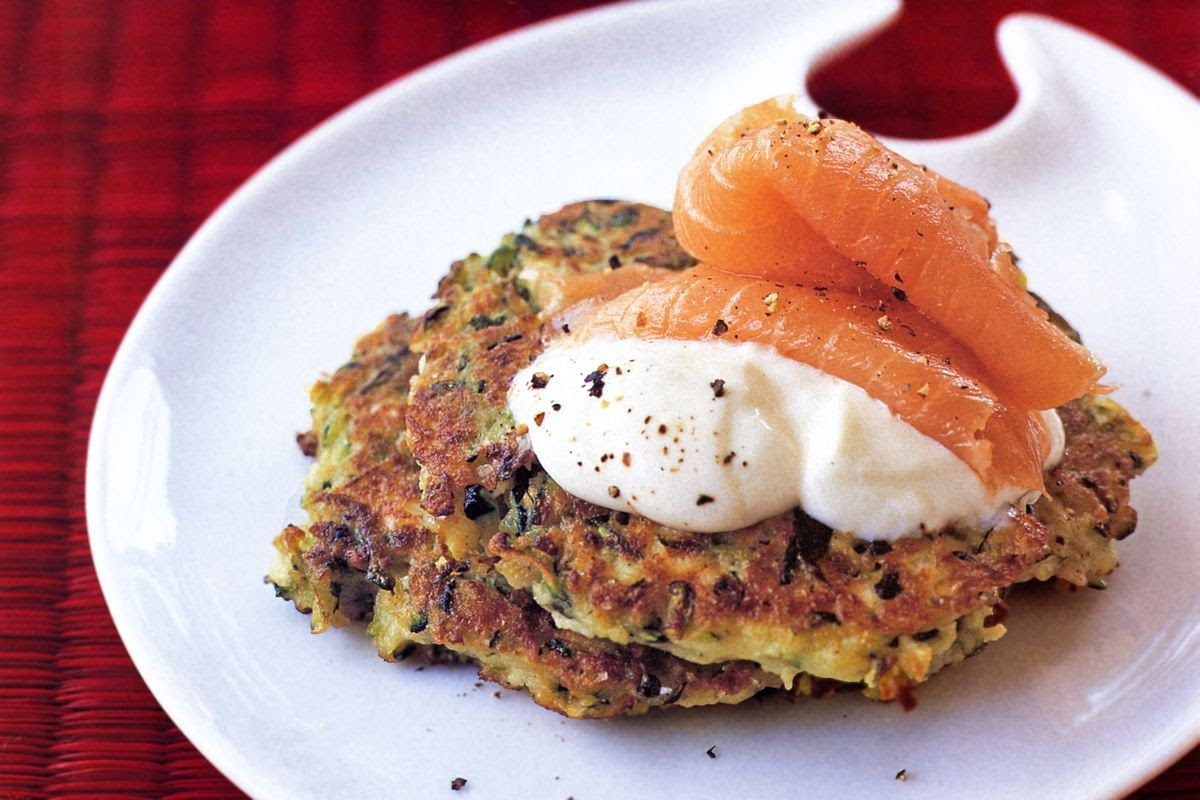 Zucchini fritters with sour cream and smoked salmon - Recipes - delicious.com.au