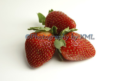 red ripe strawberries against a white background