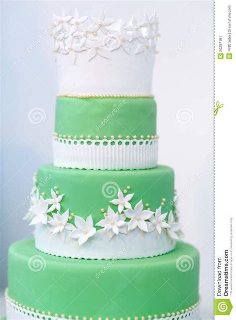 Green Wedding Cake Decorated With White Flowers Stock