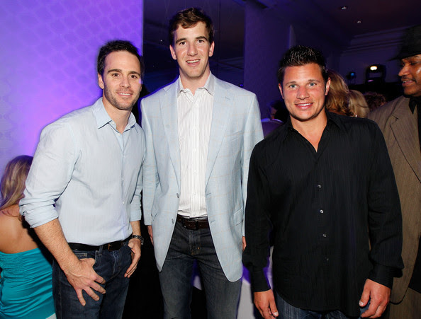 (L-R) NASCAR driver Jimmie Johnson, Eli Manning of the New York Giants and singer/TV personality Nick Lachey attend the Super Skins Kick Off Party at Hotel 944 featuring Snoop Dogg at The Eden Roc Renaissance Miami Beach on February 4, 2010 in Miami Beach, Florida.
