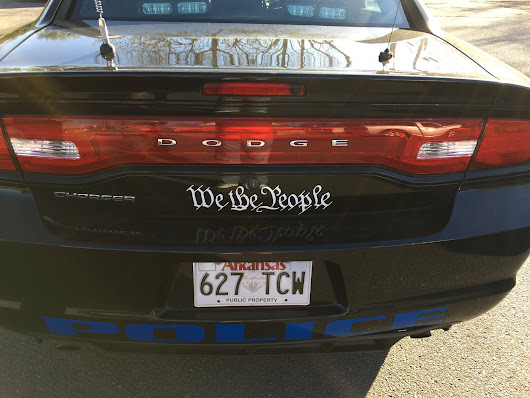 "Defying ""In God We Trust"" Trend, Arkansas Police Department Puts ""We the People"" On All Vehicles"