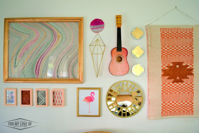 eclectic gallery wall with pops of peach, pink, magenta, gold and grey