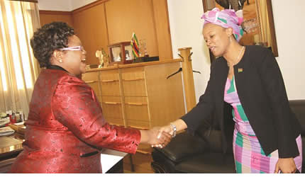 Acting President Joice Mujuru welcomes Malawian Ambassador to Zimbabwe Jane Kambalane at her Munhumutapa offices in Harare on June 5, 2013. by Pan-African News Wire File Photos