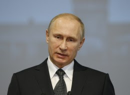 Russian President Vladimir Putin said agreements had been signed, one declaring the cease-fire in Ukraine, the other to implement it. (AP Photo/Alexander Zemlianichenko, Pool)