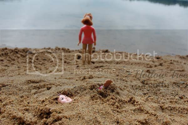 As The Dollhouse Turns - buried in sand