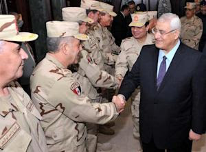 A photo released by the Egyptian presidency shows interim …