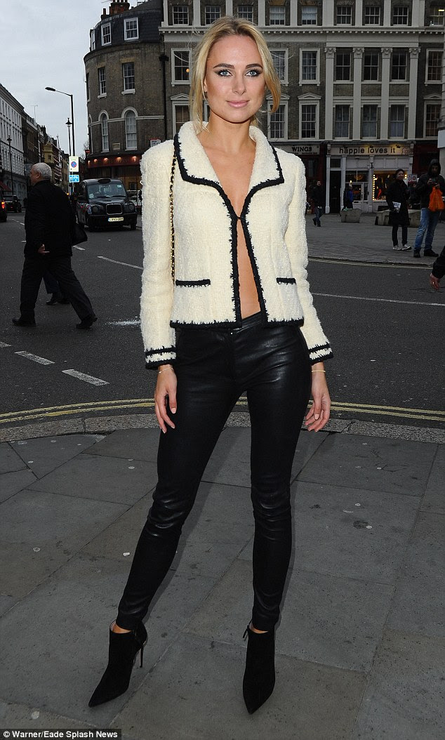 She's confident: Garner flashed her taut torso as she modelled her monochrome ensemble