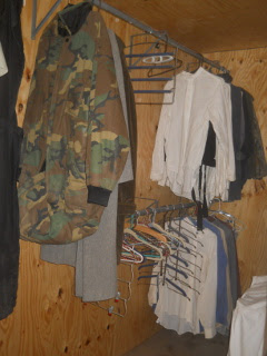 Clothes Hanging Double Stacked in the Bedroom Closet