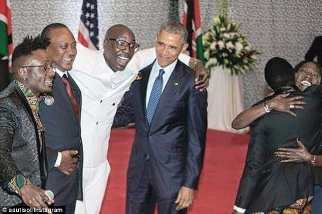 Kenyan President Uhuru Kenyatta (second from left) also accompanied Obama during the dance. Above, the presidents pose with Sauti Sol member Delvin Mudigi (left) and group leaderBien-Aimé Baraza (third from left)