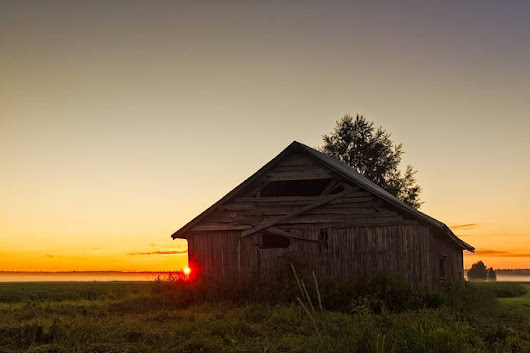"""Midsummer Sunset Behind A Barn House"" by k009034"