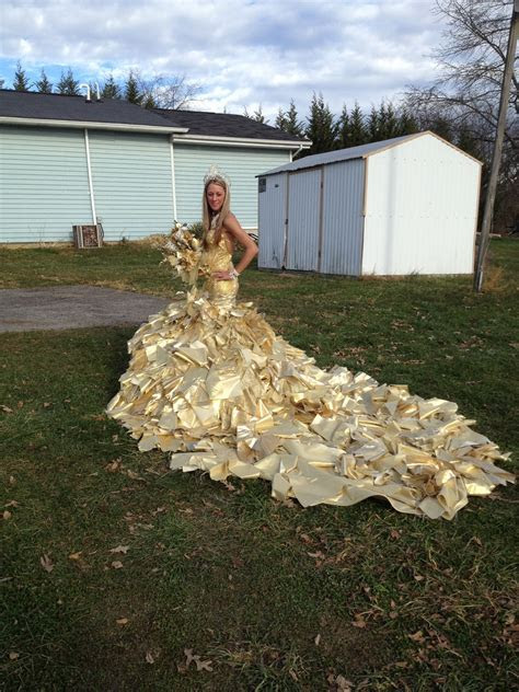 Gold lame, brocade, re embroidered organza and 24karat