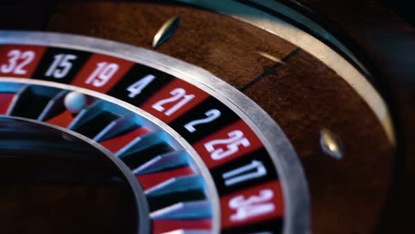 Close Up Of A Small White Ball Gets Into A Slot In A Russian Roulette Wheel Stock Video Footage Dissolve