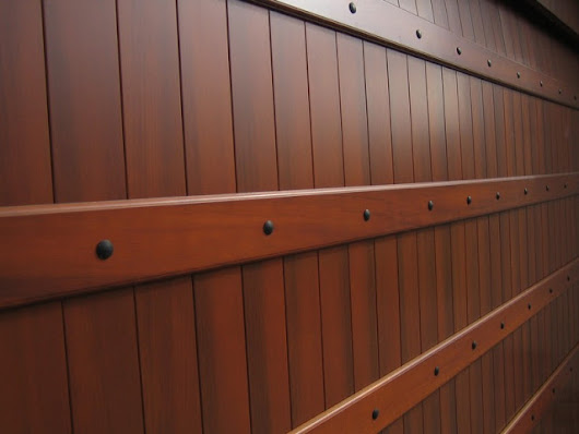 Give Your Bland Garage Door A Faux Wood Grain Finish! -