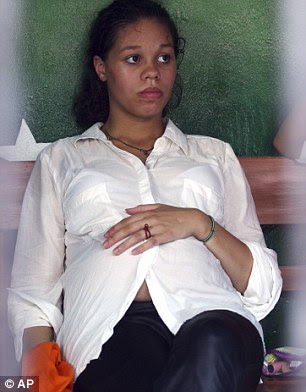 Seven-months pregnant Heather Mack (pictured), 19, and her lover Tommy Schaefer, 21, were handcuffed as they arrived at court in Denpasar, Bali today