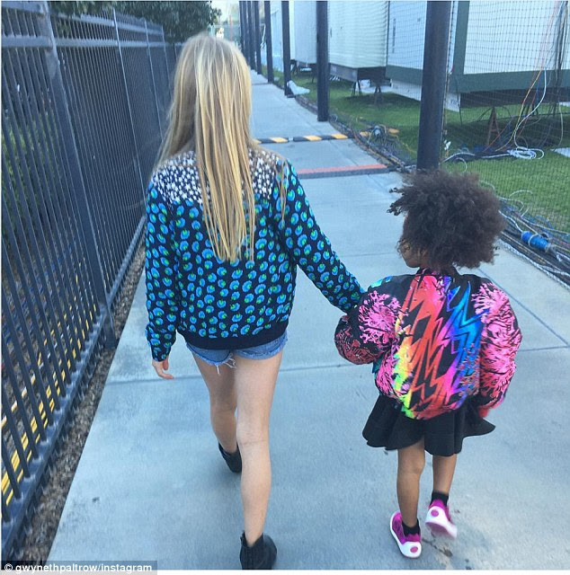 Jacket game:Just moments before the impressive show, Gwyneth took to her Instagram page to share a sweet snap of her eldest child holding hands with four-year-old Blue Ivy