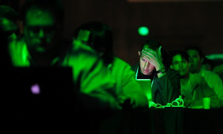 A patron works on his laptop during the Tech Crunch Disrupt conference in San Francisco, California, September 11.