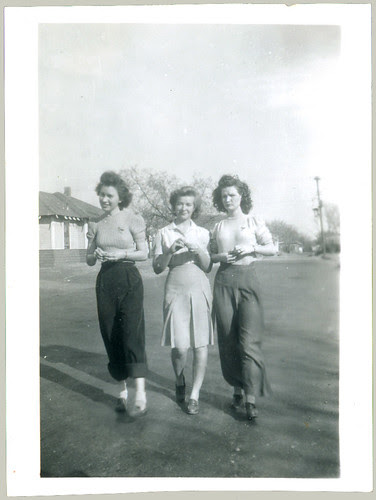 Three women with something between their fingers