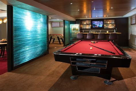 Wine Cellar and Gaming Room   Contemporary   Family Room   New York   by Jennifer Watty Interior