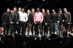 This picture provided by Starpix shows members of 98 Degrees, Boyz II Men, and New Kids on the Block, during the announcement of The Package Tour, Tuesday, Jan. 22, 2013 in New York. The major summer tour will feature the three bands. (AP Photo/Starpix, Kristina Bumphrey)