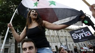 A protester shouts slogans during a rally against the proposed attack on Syria in central London on Wednesday