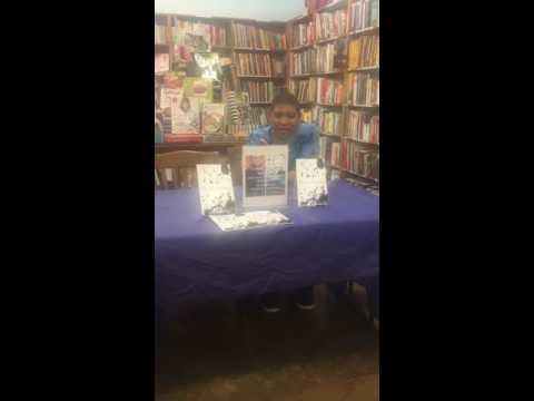 Author Tony Polanco Reading His Poetry at a Half Priced Books