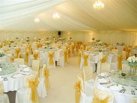 Photo of a elegant cream, white and yellow marquee wedding
