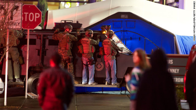 Memebers of a SWAT team take position outside the mall.
