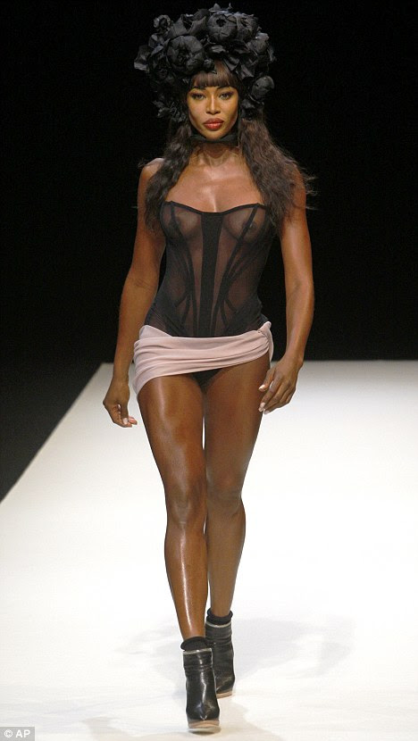 Racy: The 39-year-old showed off her toned frame in a transparent corset, with a tiny cream skirt