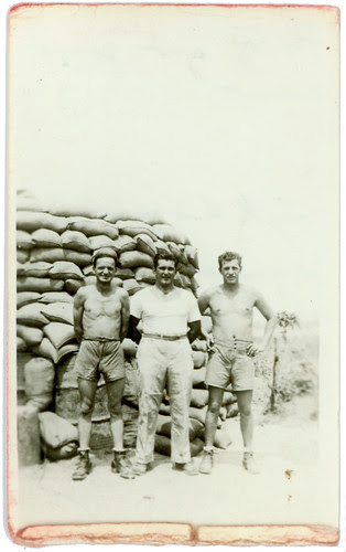 three guys and sandbags