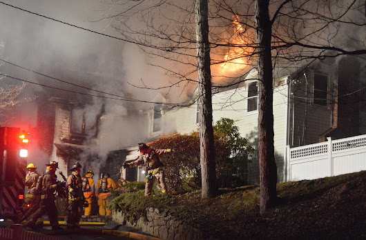 Firefighters from numerous towns battle Wilton house fire
