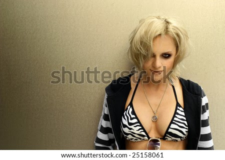 stock photo : Portrait of a punk female model in black and white bikini top