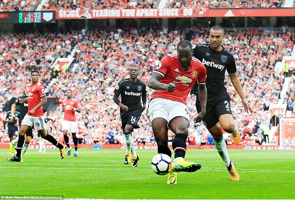 Lukaku uses the side of his left foot to guide the ball past Hart and his effort needed a deflection off the post to find the net