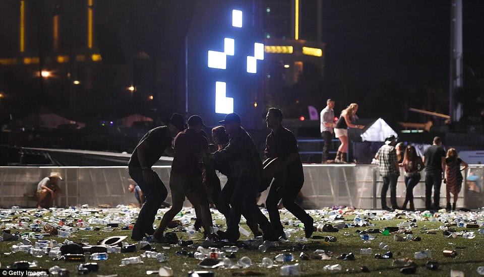 People carry a person at the Route 91 Harvest country music festival after the gunman opened fire