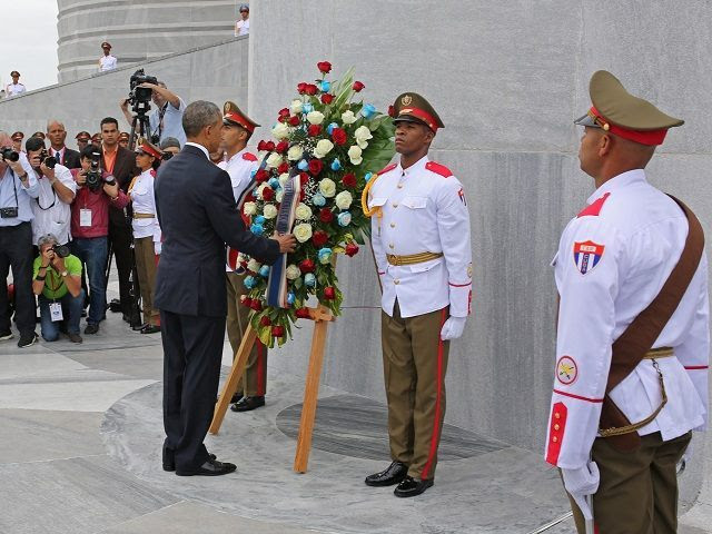 """U.S. President Barack Obama lays a wreath at the Jose Marti monument in Revolution Square in Havana, Cuba, Monday March 21, 2016. """"It is a great honor to pay tribute to Jose Marti, who gave his life for independence of his homeland. His passion for liberty, freedom, and self-determination lives on in the Cuban people today,"""" Obama wrote in dark ink in the book after he laid a wreath and toured the memorial dedicated to the memory of Jose Marti. (AP Photo/Enric Marti))"""