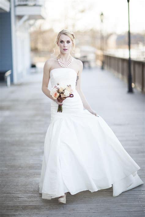 Bride wears white strapless mermaid wedding dress with