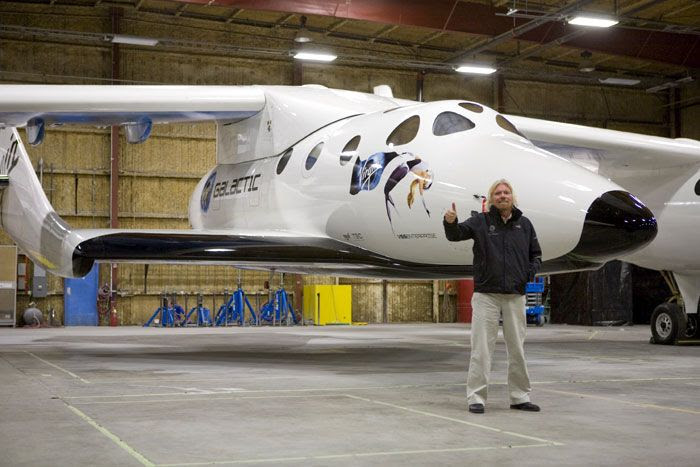 Virgin Galactic owner Sir Richard Branson poses in front of SpaceShipTwo.