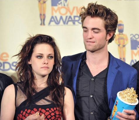 Kristen Stewart And Robert Pattinson Kissing In Public. (From L) Kristen Stewart and