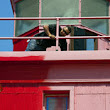 Holland's Big Red lighthouse receiving a fresh coat of paint