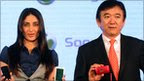 Bollywood actress and brand ambassador for Sony Ericsson Kareena  Kapoor with Sony Ericsson's Hirokazu Ishizuka